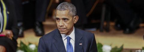 Obama seeks to reduce racial division at memorial for slain police