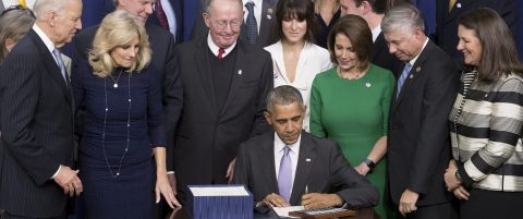 Obama signs law for investments to fight cancer, heroin epidemic