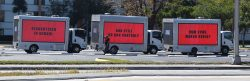 Giant signs in Miami ask senator to do something about gun control