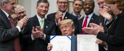 Trump signs law easing post-crisis regulation of banks