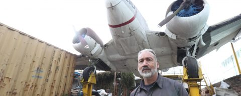 Prop plane looming over scrapyard becomes icon in Uruguay's capital
