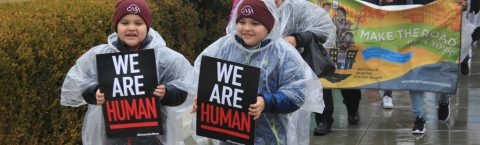 Hundreds march in the rain against Trump's immigration policy