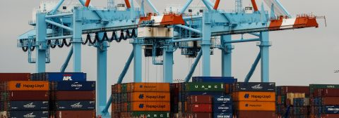 US trade deficit drops 15 pct. thanks to record exports
